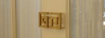 Custom designed door handles for all showroom doors.