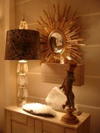 Showroom vignette with vintage oval sunburst mirror